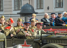 Young people in the  uniform of the Second World War. Royalty Free Stock Photos