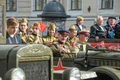Young people in the  uniform of the Second World War. Royalty Free Stock Images