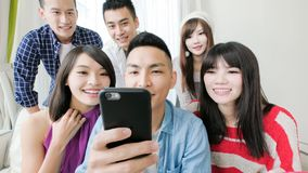 Young people use phone Royalty Free Stock Images
