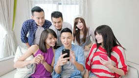Young people use phone Stock Photography
