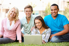 Young people using laptop outdoors Stock Photos