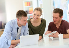 Young people using leptop and tablet royalty free stock images