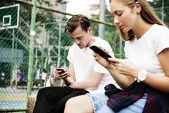 Young people using mobile phone stock photos