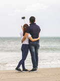 Young people using selfie stick in China Beach of Danang Stock Photos