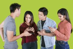 Young people using smartphone on studio royalty free stock image