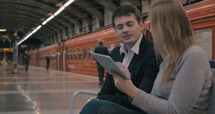Young people using tablet PC in the subway stock video