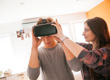 Young People Using VR. In The Living Room Royalty Free Stock Photos