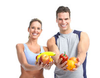 Young people with vegetables and fruits Royalty Free Stock Photography