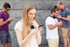 Young people in virtual world. Young people using smartphones in their own virtual world Stock Photo