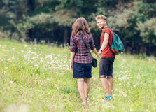 Young people walk outdoor Royalty Free Stock Photos