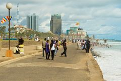 Young people walk by the seaside in Colombo, Sri Lanka. Colombo, Sri Lanka - May 17, 2011: Unidentified young people walk by the seaside in Colombo, Sri Lanka stock images