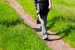 Young people walking along a rural farm track Royalty Free Stock Image