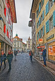 Young people walking along the street in Lucerne Stock Photo