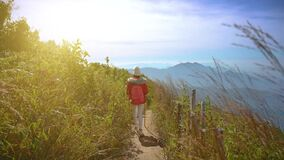 Young people walking on a hilltop in Doi Inthanon, Chiang Mai, Thailand