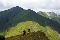Young People Walking On A Mountain Royalty Free Stock Photos