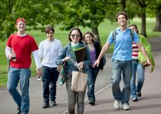 Young people walking outdoors Stock Image