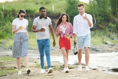 Young people walking outdoors royalty free stock photo