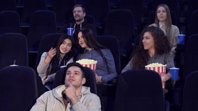 Young people watch film at the movie theater stock video footage