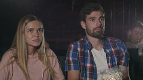 Young people watch movies carefully in cinema stock video