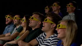 Young people watch movies in cinema: comedy in 3D stock video footage