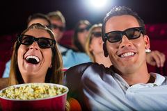 Young people watching 3d movie at movie theater. Having fun Royalty Free Stock Image