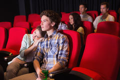 Young people watching a film Royalty Free Stock Photos