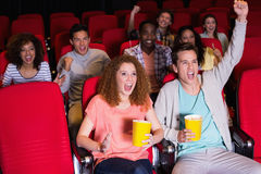 Young people watching a film Stock Image