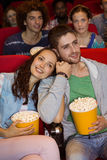Young people watching a film Royalty Free Stock Photography