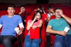 Young people  watching a movie Royalty Free Stock Images