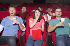 Young people  watching a movie Stock Image