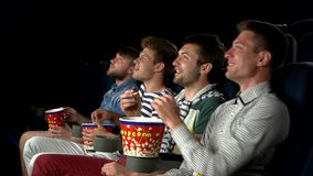 Young people watching movie in cinema. eating stock video
