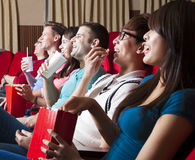 Young people  watching a movie at the cinema Stock Image