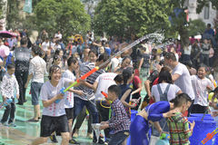 Young people in a water fight Stock Images