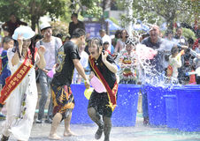Young people in a water fight Stock Photography