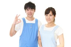 Smiling man with woman. Young people wearing apron isolated on white background stock photos