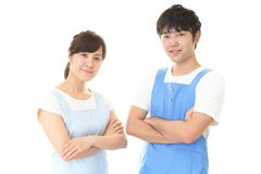 Smiling man with woman. Young people wearing apron isolated on white background stock photography