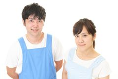 Smiling man with woman. Young people wearing apron isolated on white background royalty free stock image