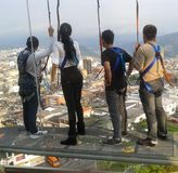 Young people wearing a harness in a viewpoint of a city, tourist lookout. royalty free stock image