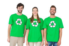 Young people wearing recycling symbol tshirts. Portrait of three young people wearing recycling symbol tshirts over white background Stock Photography