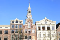 Young people in windows of traditional old buildings in Amsterda Royalty Free Stock Image
