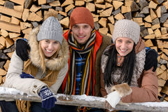 Young people in winter clothes posing outside Stock Image