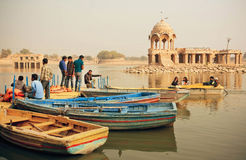 Young people and women meeting on riverboats dock with ancient indian towers in India Stock Photography