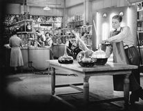 Young people working in a chemistry lab. (All persons depicted are no longer living and no estate exists. Supplier grants that there will be no model release Stock Images
