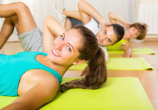 Young people working in gym Royalty Free Stock Photos