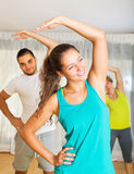 Young people working in gym Royalty Free Stock Image