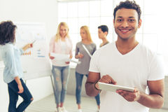 Young people working Stock Image