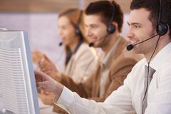 Young People Working In Callcenter Smiling Stock Images