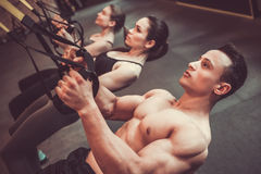 Young people working out with TRX Stock Photos