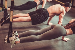 Young people working out with TRX stock image