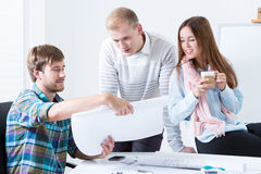 Young people working in pleasant atmosphere Royalty Free Stock Image